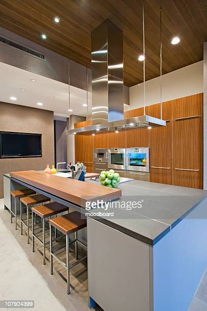 Wood panelled spotlit kitchen in California home