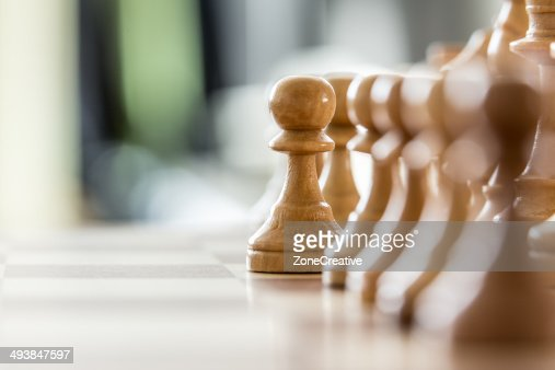 Wood pawns : Stock Photo