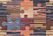 Wooden puzzles assembled for seamless background pattern. Will tile endlessly.