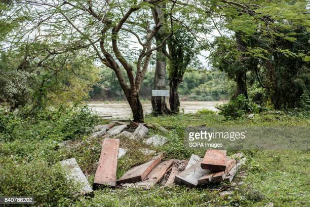 Wood seized from Illegal logging operations is piled up in the center of Kbal Romeas village Local communities refuse to be removed Once the dam is...