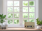 Wood shelf located by the window 3d rendering image.Decorate with vintage radio.There are white wood window  look out to see the nature