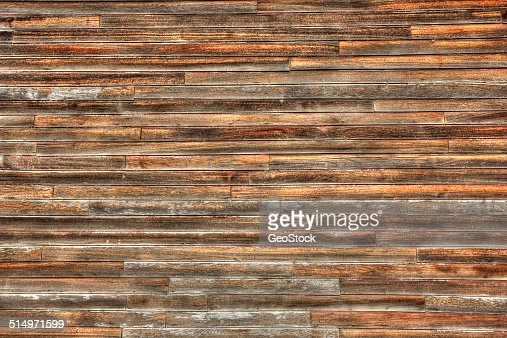 7 Popular Siding Materials To Consider: Wood Siding Of An Oldfashioned Grain Elevator Stock Photo