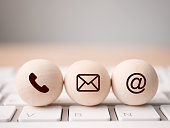 Wood sphere symbol telephone, mail, address and mobile phone. Website page contact us or e-mail marketing concept