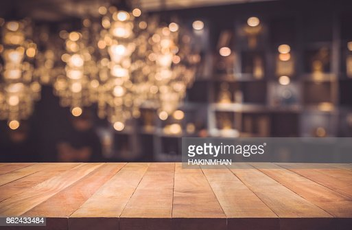 Wood table on blur cafe (restaurant) background : Foto de stock