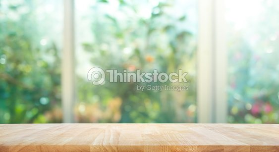 Wood table on blur of window with garden flower background : Stock Photo