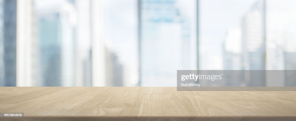 Beau Wood Table Top And Blur Glass Window Wall Building Banner Background :  Stock Photo