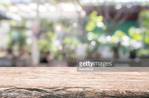 Wood table top and blurred restaurant exterior background. : Stock Photo
