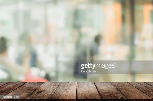 Wood table top and blurred restaurant interior background - can used for display or montage your products. : Stock Photo
