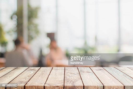 Wood table top and blurred restaurant interior background : Stock Photo