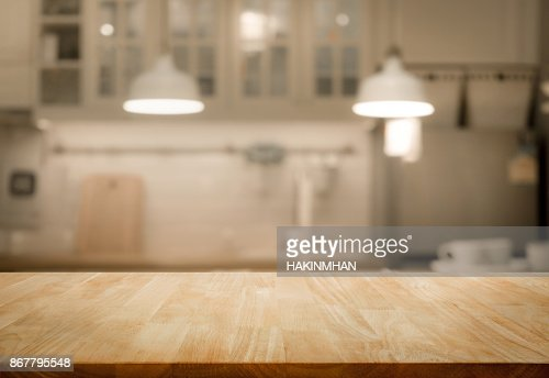 Wood table top on blur kitchen wall room background : Stock Photo