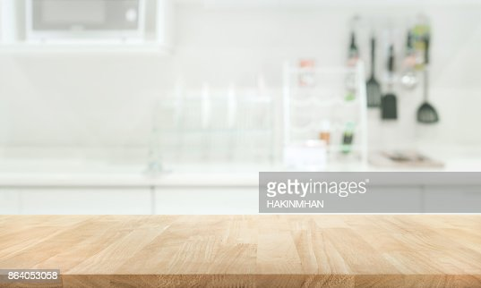 Wood table top on blur white kitchen wall room : Stock Photo