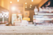 Wood table top with Abstract blur Coffee shop background with bokeh, For create montage product display