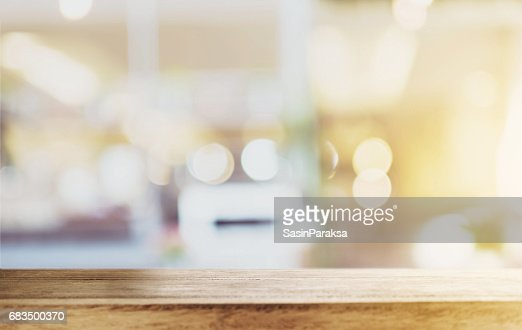Wood table top with blurred defocus backgrounds : Stock Photo