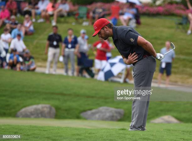Wood takes a bow after sinking a chip shot after struggling most of the day during the second round of the PGA Championship on August 11 2017 at...
