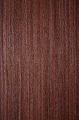 Wood - Rosewood Wood Veneer . High resolution natural woodgrain texture. Close-up. Photographed on Canon 5d mkIII + Canon EF 100mm f/2.8L Macro IS USM Lens. Developed from RAW, Adobe RGB color profile
