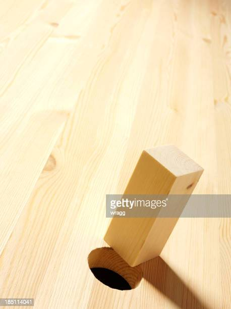 Wood with Square Peg and a Round Hole