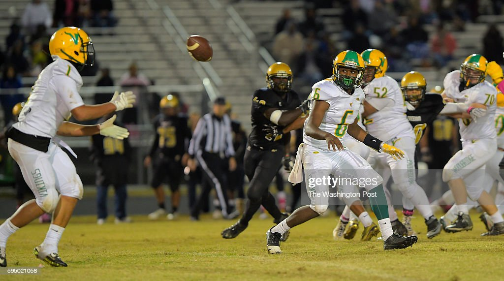 Woodbridge's Dashaun Jerkins left takes as pitch out from QB Brandon Pitt as Woodbridge plays Freedom at Freedom High School in Woodbridge VA October...