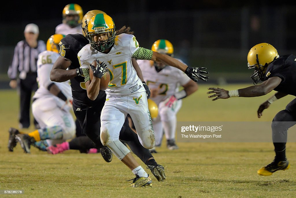 Woodbrodge RB Deandre Morton makes as long 3rd quarter gain as Woodbridge plays Freedom at Freedom High School in Woodbridge VA October 30 2015