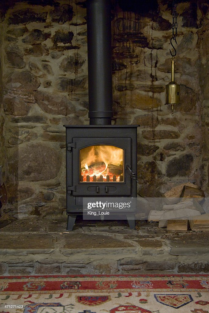A wood-burning stove inside of an older home