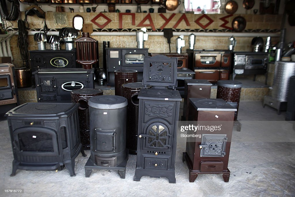 Wood-burning stoves stand for sale on the floor of a heating supply store in Athens, Greece, on Friday, Dec. 7, 2012. Greece, the epicenter of Europe's debt crisis since revealing a bloated spending gap in late 2009, has faced regular demands to get a firmer grip on the budget or risk being forced out of the euro. Photographer: Kostas Tsironis/Bloomberg via Getty Images