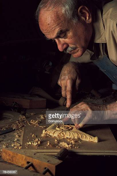Woodcarver performing his craft