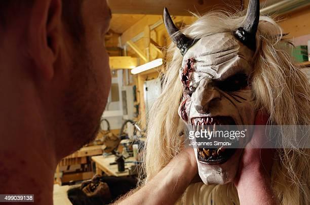 Woodcarver Richard Kranawetvogl reviews a ready Krampus or devil's mask in his workshop on November 28 2015 in Marktschellenberg Germany Kranawetvogl...