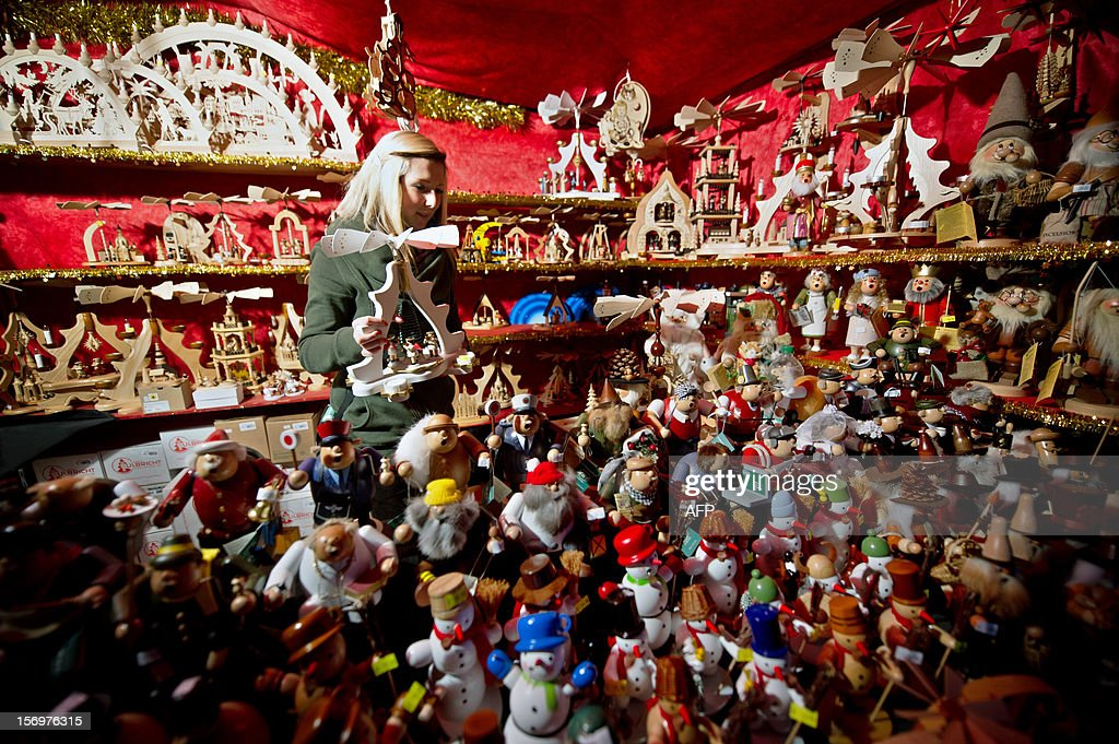 Woodcut crafted figures are arranged in a booth at the Striezel christmas Market in Dresden, eastern Germany, on November 26, 2012.
