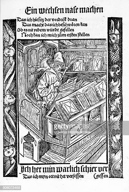 Woodcut of a Medieval book collector sitting at a desk reading Dated 1494 Photo by