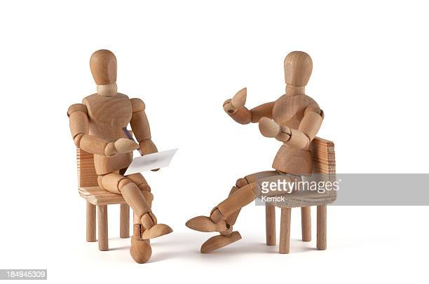 Wooden art mannequins set up as if they were talking