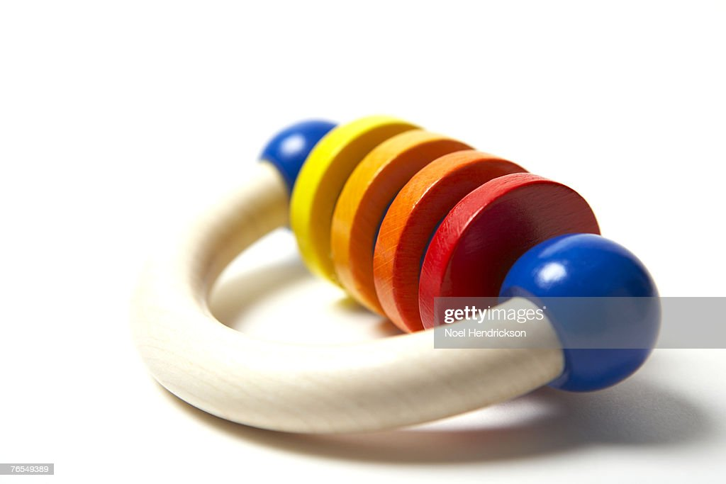Wooden baby rattle, close-up : Stock Photo