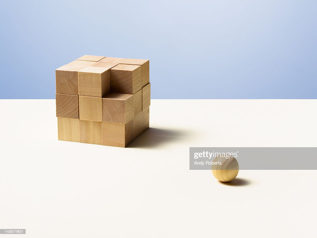 Wooden ball with wooden cube : Stock Photo