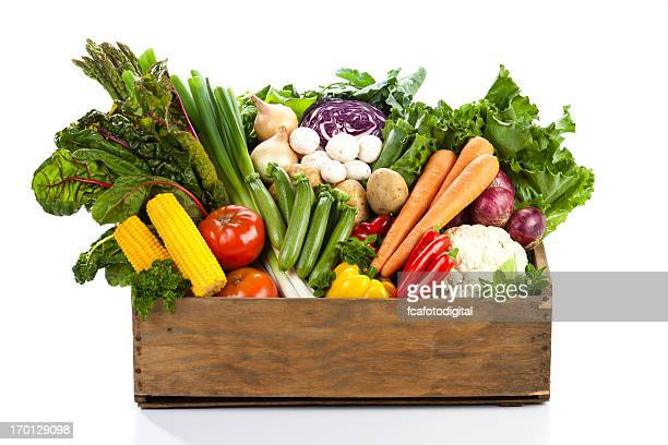 Wooden basket filled with different types of vegetables