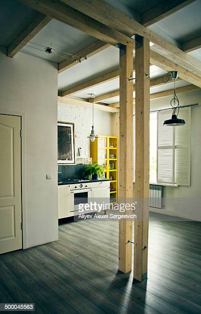 Wooden beams in loft kitchen