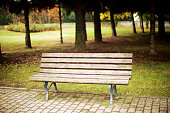 Wooden bench in tranquil park in Italy