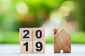 2019 wooden block number with wooden house. Using for Happy new year 2019 , business and property concept.