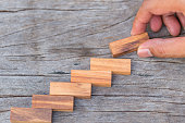 Wooden block stacked is concept of structure, building, strategy and growing up