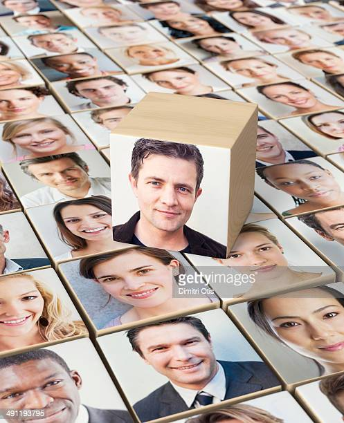 Wooden block with portrait of man on other blocks