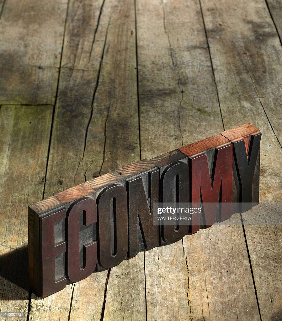 Wooden blocks spelling economy : Stock Photo