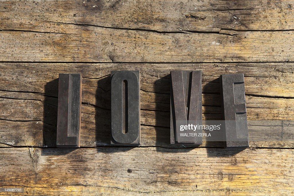 Wooden blocks spelling love : Stock Photo