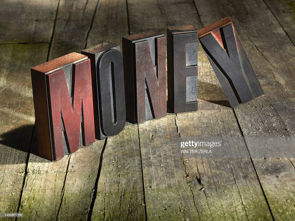 Wooden blocks spelling money : Stock Photo