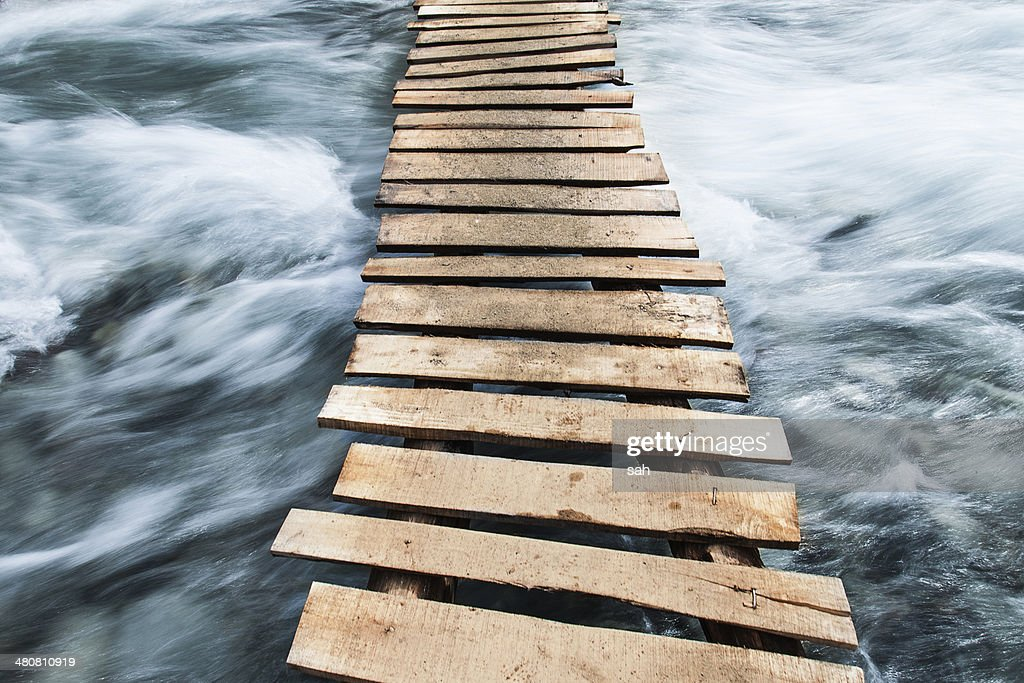 Wooden boardwalk across water