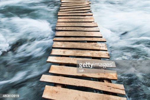 Wooden boardwalk across water