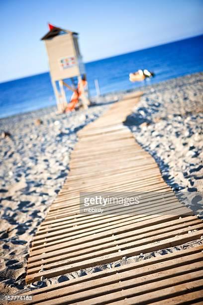 Wooden boardwalk towards beach