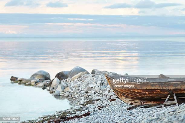 Wooden boat on rocky coast