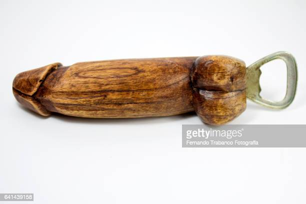 Wooden bottle opener with penis shape