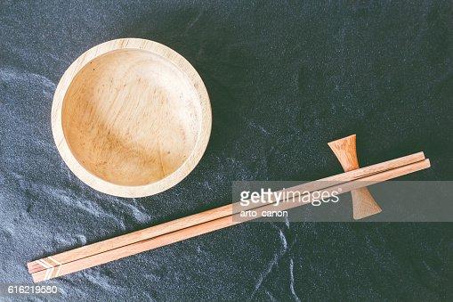 Wooden bowl and wooden chopsticks : Bildbanksbilder