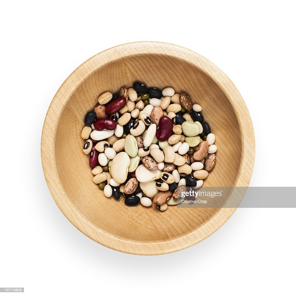 Wooden bowl of assorted dried beans : Stock Photo