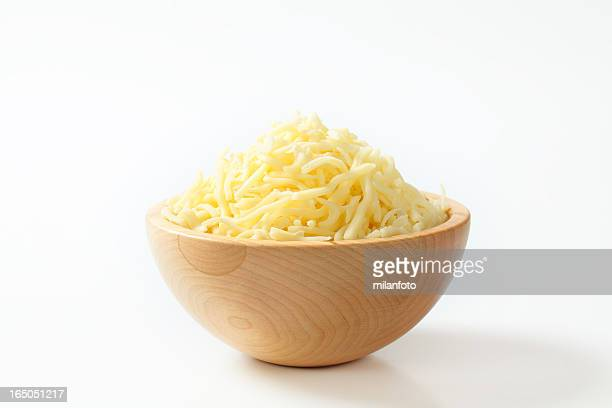 Wooden bowl with  grated cheese