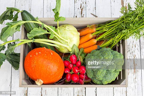 Wooden box of different vegetables