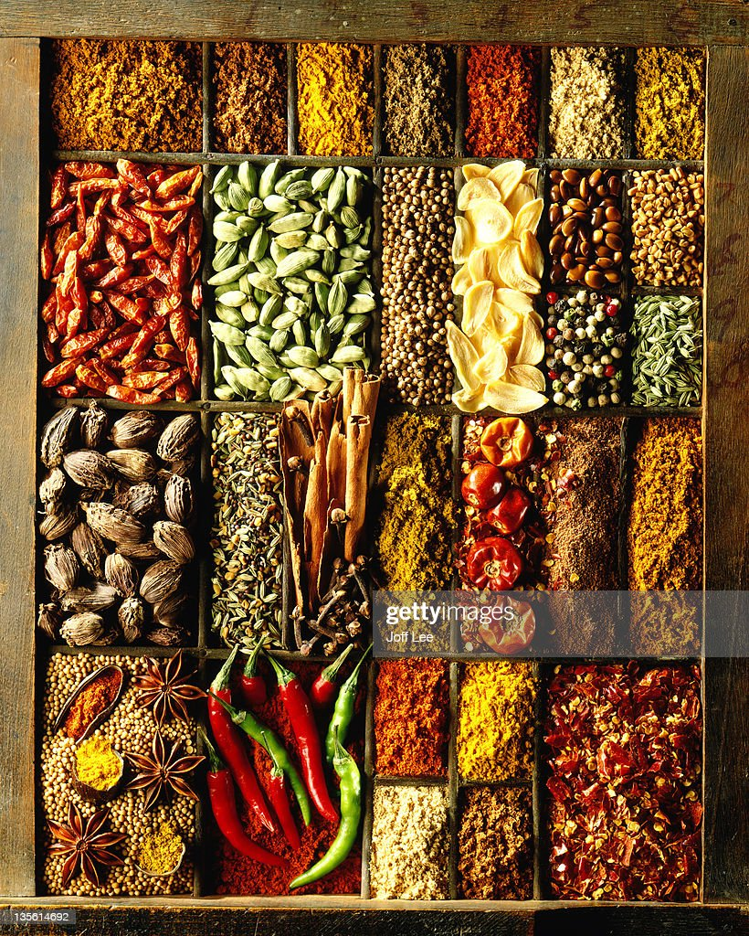 Wooden box with assorted spices in compartments